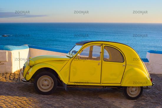 Retro car on the ocean