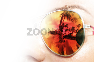 Palm trees reflect in sunglasses