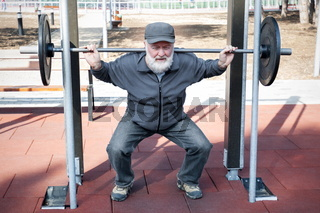 Old man doing fitness