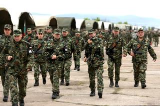 Bulgarian soldiers in uniforms with Kalashnikov AK 47 rifles