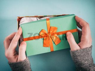 female hands opening gift box
