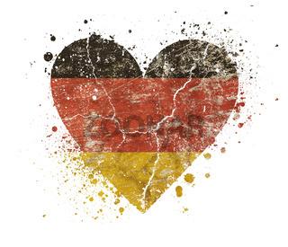 Heart shaped grunge vintage faded German flag