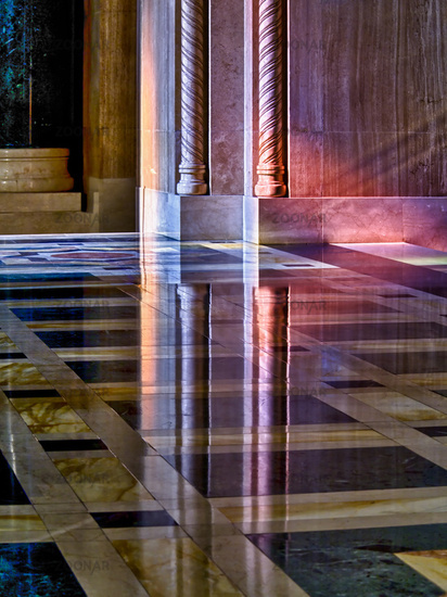 Light from stained glass windows on wall of church