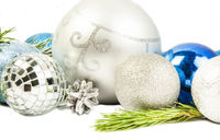New year and Christmas composition with fir tree branch, beautiful silver ball and silver cones isolated on white