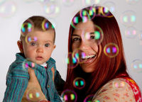 Mother and son looking at bubbles
