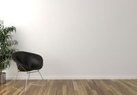 Solo black chair, interior plant and blank wall in background