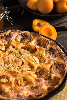 Homemade apricot tart with almonds and fresh fruits