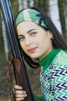 Portrait of a girl with a gun