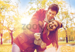 happy young couple hugging in autumn park