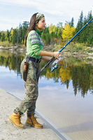 Beautiful girl at the autumn fishing in Siberia