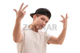 Young handsome rap dancer in black baseball cap