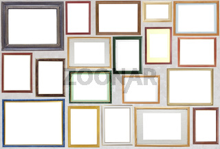 Various wooden photo frames  hang on a wall