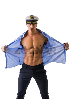 Muscular shirtless male sailor with marine hat