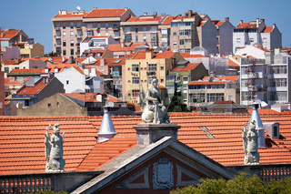 The view of pediment  decorated with sculptures on the old house in Alfama. Lisbon. Portugal