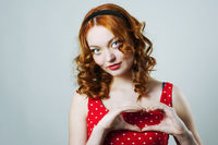 Woman with heart shaped fingers