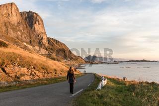 Woman walking on a road in Lofoten