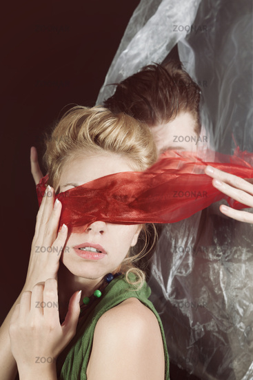 Portrait of young man and woman blindfolded