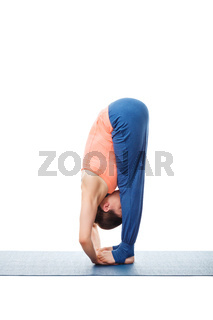 Woman doing Ashtanga Vinyasa Yoga asana Padahastasana