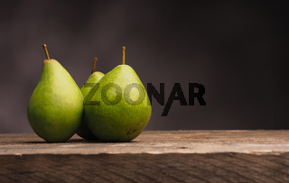 Three pears on wood