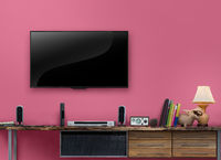 Led tv wooden table with pink wall in livingroom