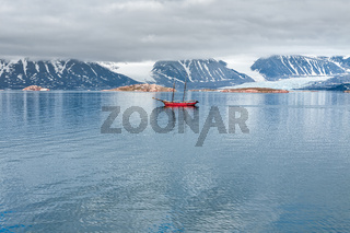Glacier, mountains and sailing ship in Svalbard islands