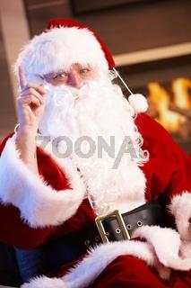 Santa Claus raising finger