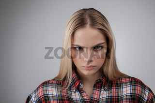 Portrait of a angry young beautiful hipster blonde teenage, Isolated on white background