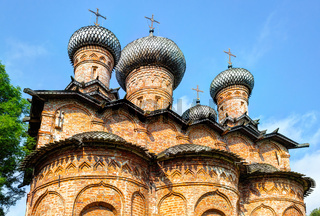 Ancient russian orthodox church with wooden domes and crosses against the blue sky in Novgorod, Russia