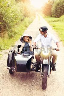 beautiful couple on retro motorbike