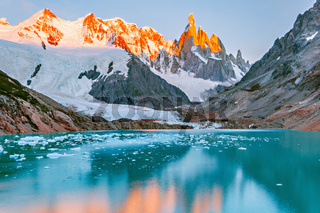Amazing sunrise view of Cerro Torre mountain by the lake.