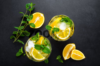 Lemon mojito cocktail with mint, cold refreshing drink or beverage, view from above