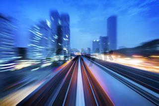 High speed train passing in between Kuala Lumpur City