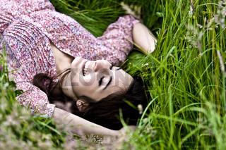 Cute Girl Lying On Grass