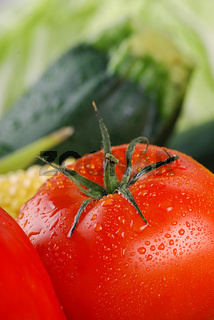 Closeup of tomato and raw vegetables