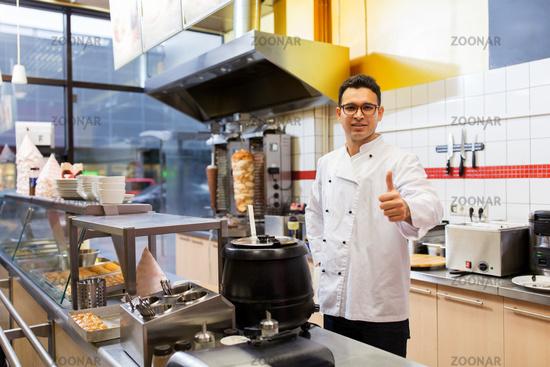 chef at kebab shop showing thumbs up