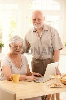 Portrait of senior couple with laptop