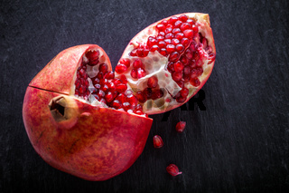 Pomegranate on a stone plate