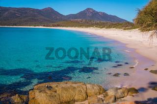 Crystal-clear waters of Wineglass Bay beach, Tasmania