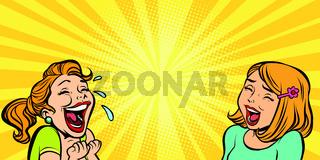 Two cheerful girlfriend girls laugh