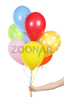 Hand holding balloons on white