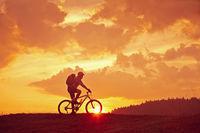 Sunrise with biker
