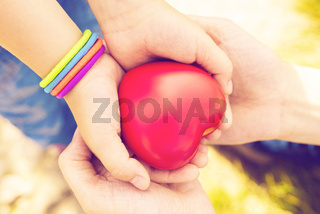 close up of child and mother hands with heart