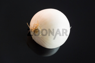 Three whole fresh raw white onions