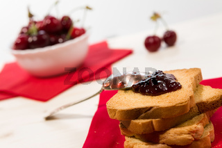 Closeup of rusk with cherry jam