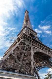 Eiffel Tower in Paris, France on a blue sky