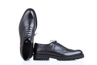 Male derby shoes on white background