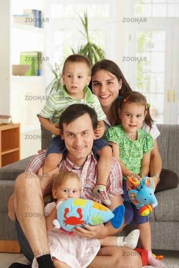Portrait of happy family with three children