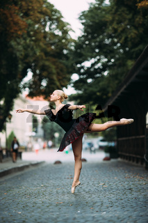 Ballerina posing in the center city