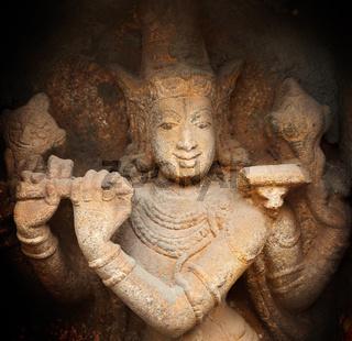 Krishna bas relief in Hindu temple. Sri Ranganathaswamy Temple. Tiruchirappalli (Trichy), Tamil Nadu, India
