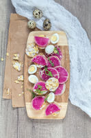 Tasty nutritious grain breads with red radish.